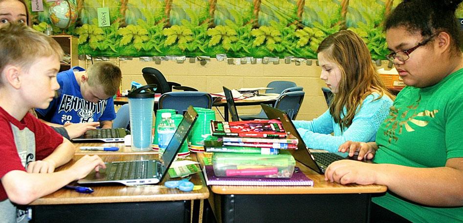 Children using computers from classroom grants in Bennington, NE Schools